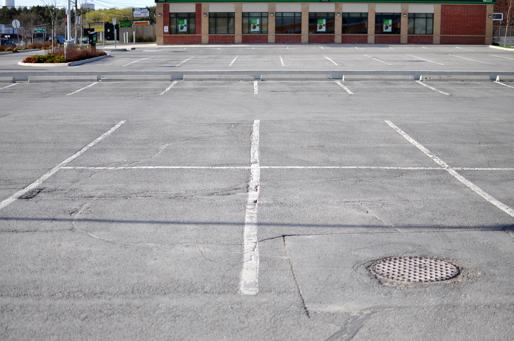 Commercial parking lot in need of preventative maintenance